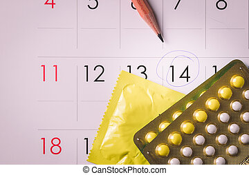 Birth control pills on calendar add vignette tone