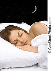 Night dreams - Portrait of the sleeping woman against the...