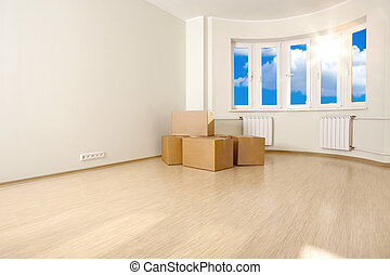 New apartment - Interior of an empty room with the boxes,...