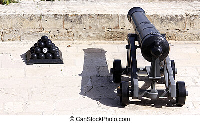 cannon and cannon balls - antique canon and canon balls