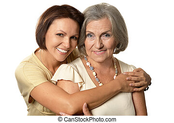 Portrait of Senior woman with daughter on a white background