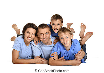 family of three people - happy family of three people lying...