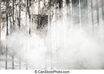 Burned coat of arms of Ukraine - Kiev, Ukraine - 02 February...