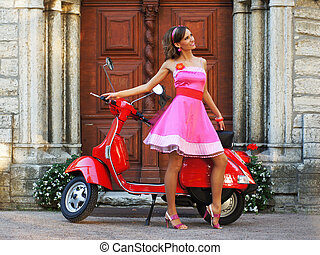 Young attractive girl with a scooter
