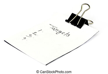 Paper clip with white paper written Targets