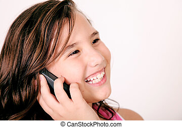 Girl talking on her mobile phone and smiling. Image space to...