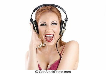 Scream - Shouting bright girl in the ear-phones, isolated on...