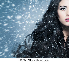 Portrait of beautiful brunette woman over grey background -...
