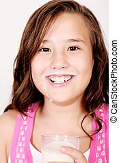 Girl drinking milk - Girl with a milk mustache. 10 years