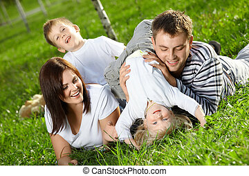 Cheerful family - Young family with two small children...