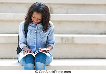 african american college student reading a book - pretty...