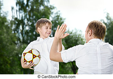 Congratulation on a victory - Small son - the football...
