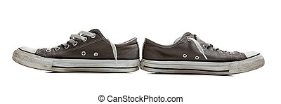 Pair of gray tennis shoes on white