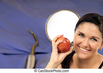 Dental Health - young woman with apple in front of a mouth...
