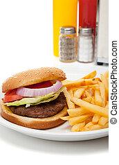 Hamburger and french fries diner set-up - A hamburger and...