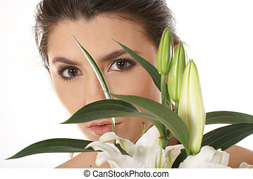 Attractive woman with lily isolated on white