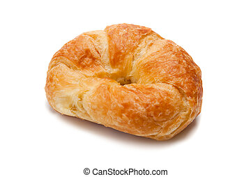 A whole croissant on white