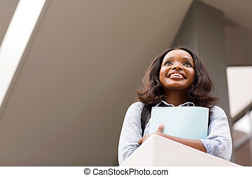 african female college student looking up - beautiful...