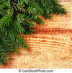 Christmas Fir Tree Branch on rustic  wood background with copy s