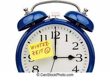 time switch to winter time - an alarm clock with a note as a...