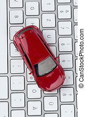 car on computer keyboard - car on keyboard symbol photo for...
