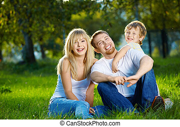 Family from three persons - Mother, father and small son...