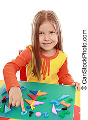 Girl makes Christmas applique - The girl is made of colorful...