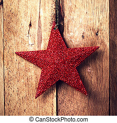 Old fashion christmas ornaments hanging on wooden...