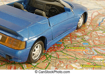 StillLife-24-0076 - Blie model car on a route map of Greater...