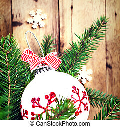 Christmas background with fir branches and festive ornaments...