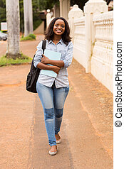 african college girl going to school - happy african college...