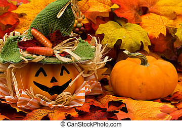 Happy Halloween - Fall leaves with a jack o lantern on a...