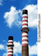 Refinery chimney stacks.