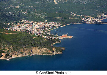 Coast of Montenegro - Kind at coast on Budva from an...