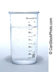 Measuring cup on white - Measuring cup with liquid on white...