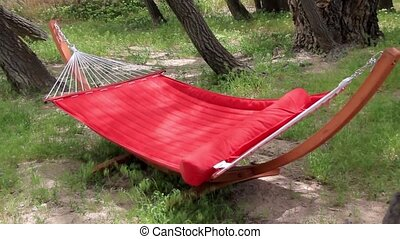 Hammock in the Forrest - Red hammock isolated over white...