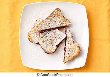 Toast Bread with Strawberry Jam Filling on Plate - Aerial...