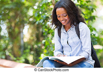 african american university student studying - smart african...