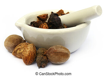 Triphala, a combination of ayurvedic fruits with mortar and...