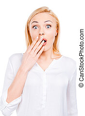 Shocking news. Surprised mature woman covering her mouth by...