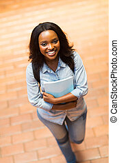 young african american college girl walking on campus -...