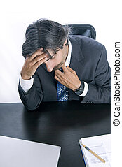 Overworked Businessman Taking a Moment to Destress -...
