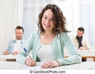 Young attractive student during lessons at school - View of...