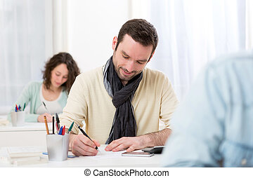 Young attractive man taking competitive exam - View of a...