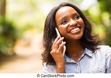 afro american woman talking on mobile phone - beautiful afro...