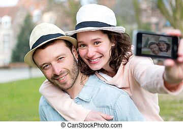 Young couple on holidays taking selfie - View of a Young...