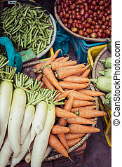 The street vendor sels his fruits and vegetables in Thamel...