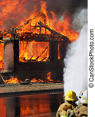 House fire - Firefighters work to extinguish a house fire