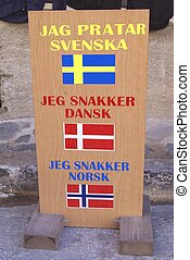 store sign - flags and information sign of a store selling...