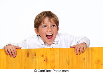 Surprised boy - Happy boy behind a board